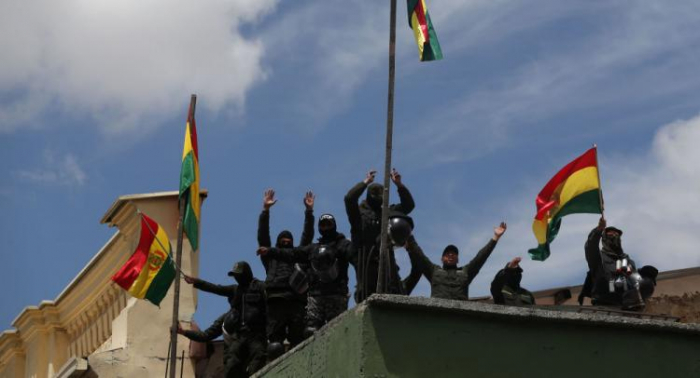 Bolivia opposition storms state-run broadcaster, radio