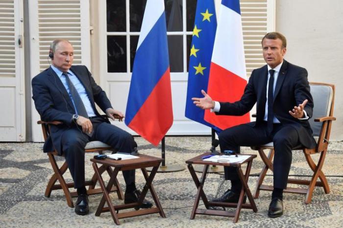 Putin and Macron discuss Ukraine summit by phone