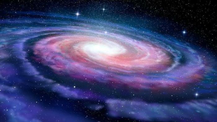 Las galaxias cambian la dirección de rotación al hacerse grandes