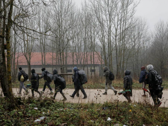 Migrants trying to cross into Slovenia 'fired at by Croatian police'