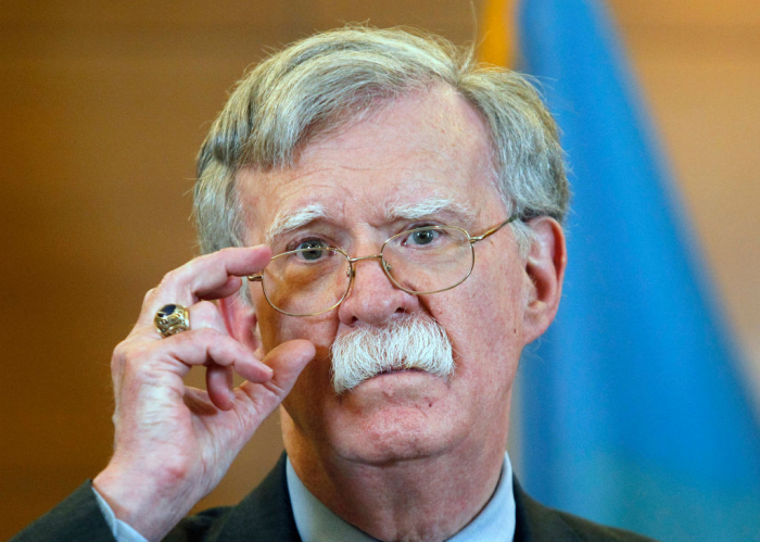 Bolton posts tweet implying White House trying to silence him