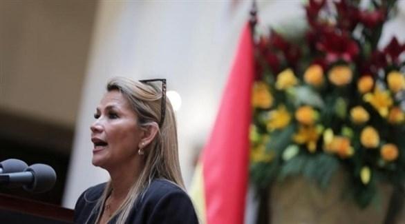 رئيسة بوليفيا المؤقتة تهدد بمحاكمة موراليس إذا عاد إلى البلاد