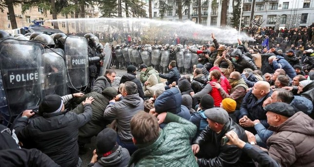 Police in Georgia disperse, detain protesters demanding early election