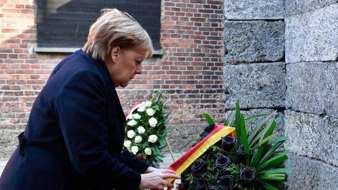 Auschwitz visit: Angela Merkel says past Nazi crimes part of German identity