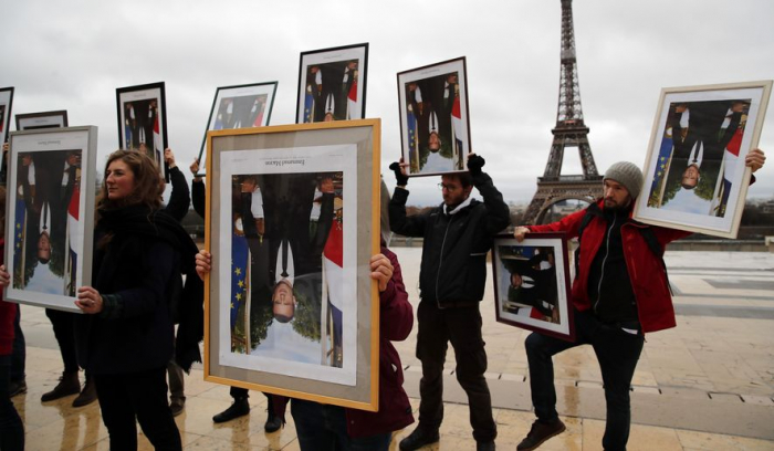 French climate activists hold stolen Macron portraits at protest-  NO COMMENT