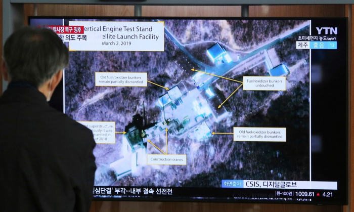Satellite images show N.Korea tried out rocket engine in