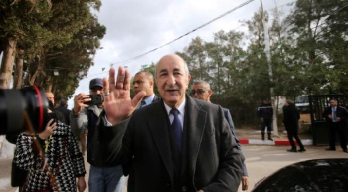 Ex-premier elected Algerian president; thousands prepare to march