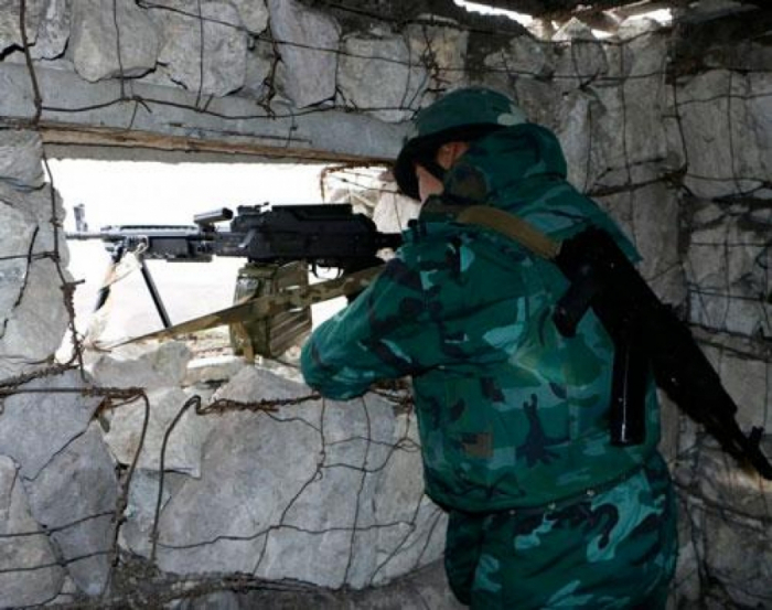Armenian military shells border posts, settlements in Azerbaijani district