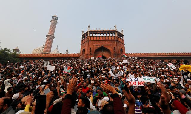 "Protesters chant ""Remove Modi"" after prayers at historic Indian mosque"