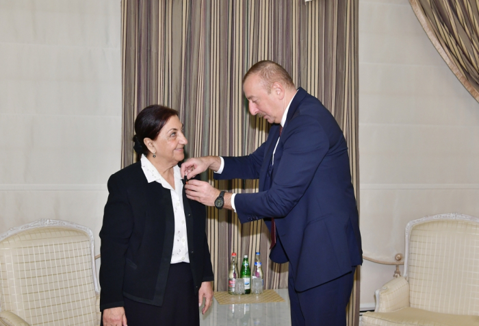 "President Ilham Aliyev presents ""Sharaf"" Order to Dilara Seyidzade"