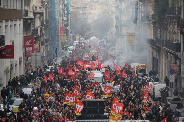 French strikers angry about pension reform cut power to homes, companies