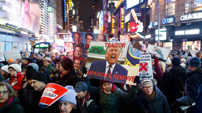 Demonstrators take to the streets in New York to  rally for Trump impeachment