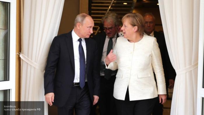 Merkel Paris görüşündən sonra Putini qalib adlandırdı