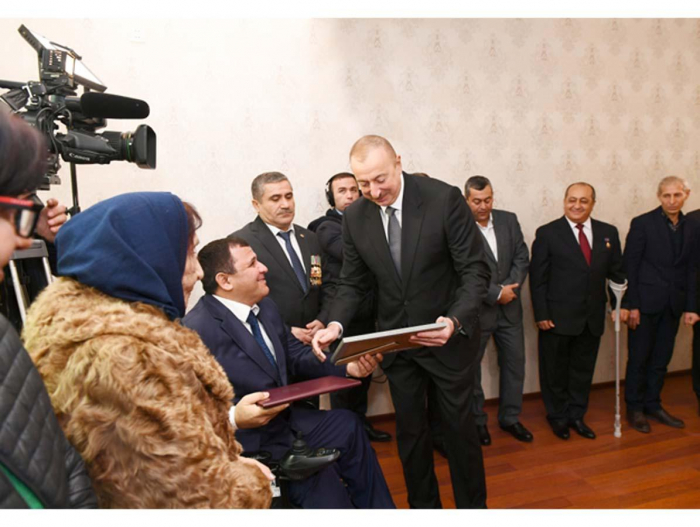 President Ilham Aliyev attends ceremony of giving out apartments, cars to veterans, families of martyrs