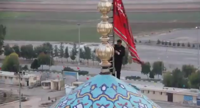 Blood red 'Flag of Revenge' raised at Shia Islam Holy Site as US-Iran tensions reach boiling point