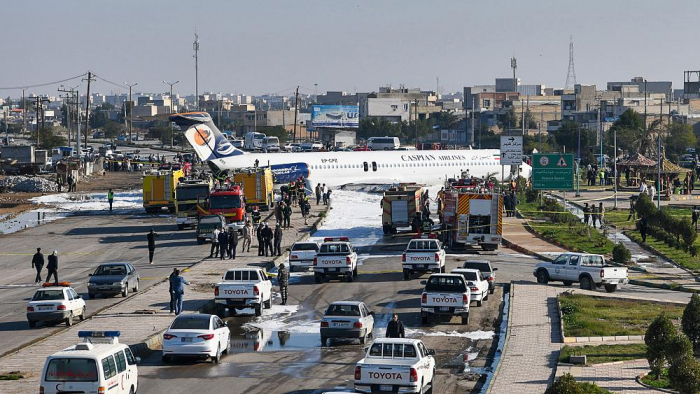 Plane overshoots runway, skids into street in Iran -   NO COMMENT
