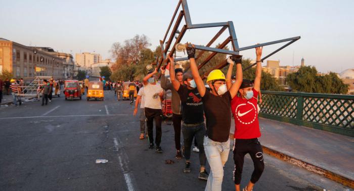 العراق... اعتقال مجموعة حاولت قطع الطريق أسفل جسر في بغداد