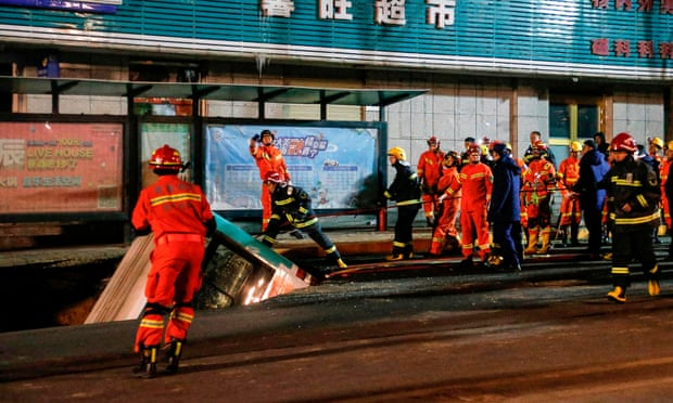 At least six dead after huge sinkhole in China swallows bus and pedestrians