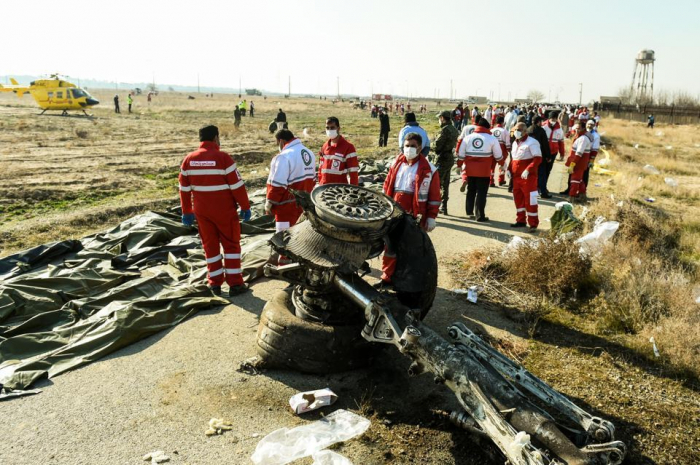 Iran hands over bodies of 150 plane crash victims to their families