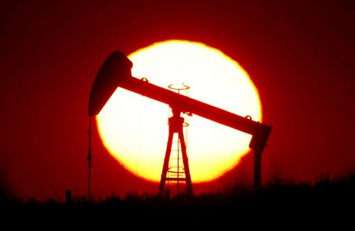 Oil ticks up, but gains capped by demand destruction