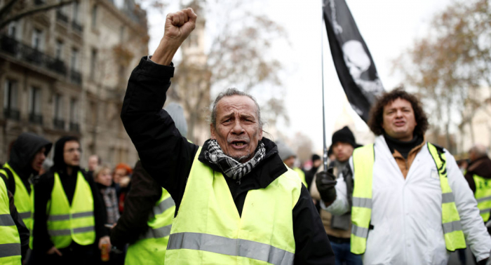 Yellow vests and trade unions take to the streets of Paris for rally