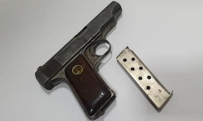 Məhkum gizlətdiyi silahı polisə təhvil verib