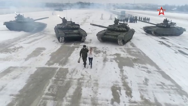Tanks for the offer: Russian soldier proposes as armed vehicles make heart shape -   NO COMMENT