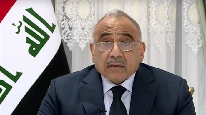 Iraqi government to quit in March, warns of vacuum