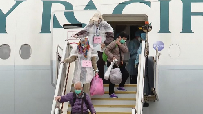 Passengers from coronavirus-hit cruise ship arrive home in Hong Kong -   NO COMMENT
