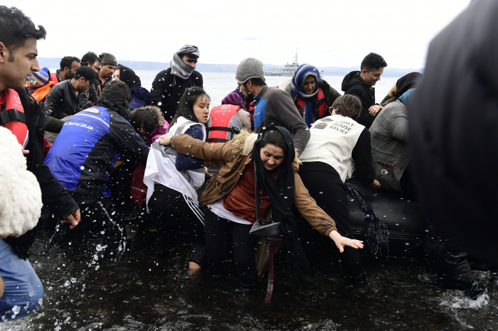 Migrants arrive in Lesbos after Turkey says it can