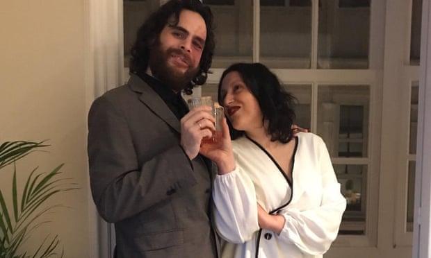 Spanish couple hold wedding from their window to beat coronavirus lockdown