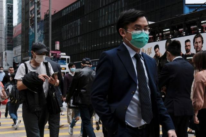 Beijing to quarantine travelers from South Korea, Japan, Iran and Italy