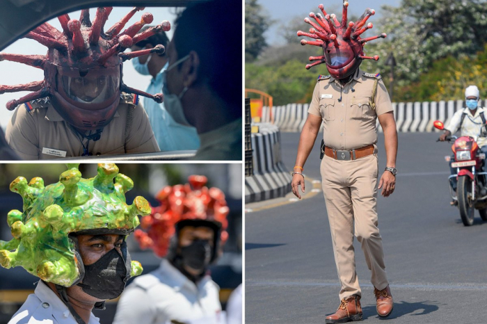 Indian police wear coronavirus helmets to spread lockdown message -VIDEO