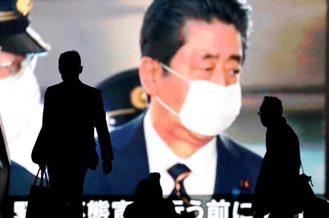 Japan prime minister criticised as tone deaf after lounge-at-home Twitter video