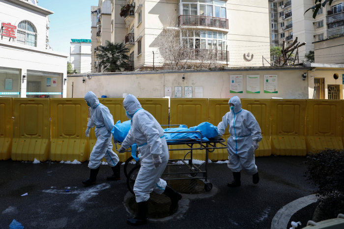 China revises its figures in Wuhan, adding 50 percent more deaths