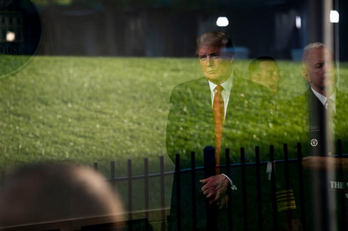 Trump plans to halt immigration, defends testing capacity
