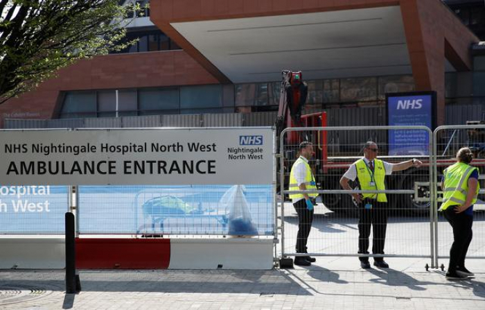 UK coronavirus death toll grows by 917 to 9,875