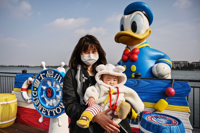 Face masks and, maybe, shorter lines as Shanghai Disneyland reopens