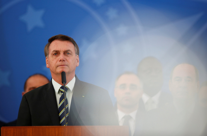 Troubles multiply for Brazil's President Bolsonaro, who calls the coronavirus 'a measly cold'