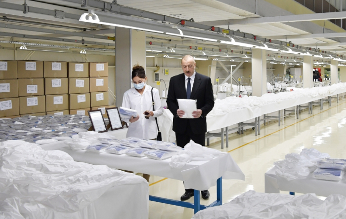 President Ilham Aliyev and first lady Mehriban Aliyeva attends opening of face mask factory and protective coverall plant