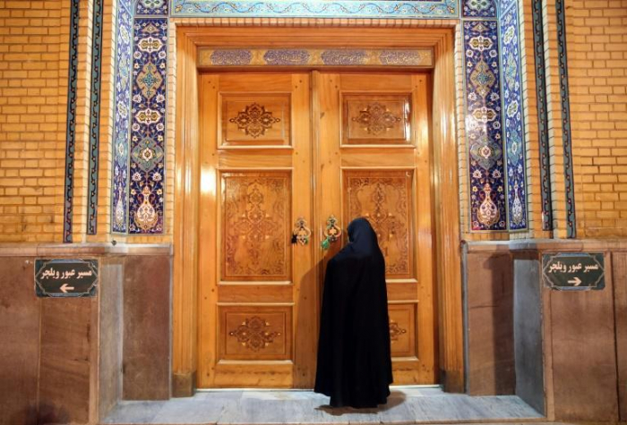 Virus-hit Iran to reopen mosques for holy nights