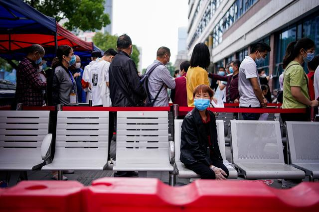 Crowds at Wuhan clinics fear coronavirus testing could rekindle disease