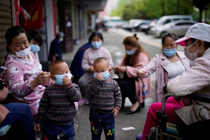 Masks too dangerous for children under two, Japan medical group says