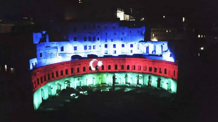 Mercati di Traiano monument complex of Ancient Rome lightened with colors of Azerbaijan