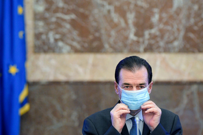 Romania's prime minister pays a fine after breaking his own coronavirus rules