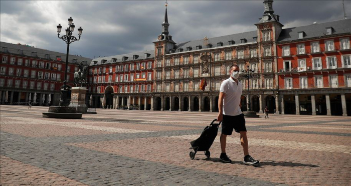 Spain sees falls in new COVID-19 deaths, cases