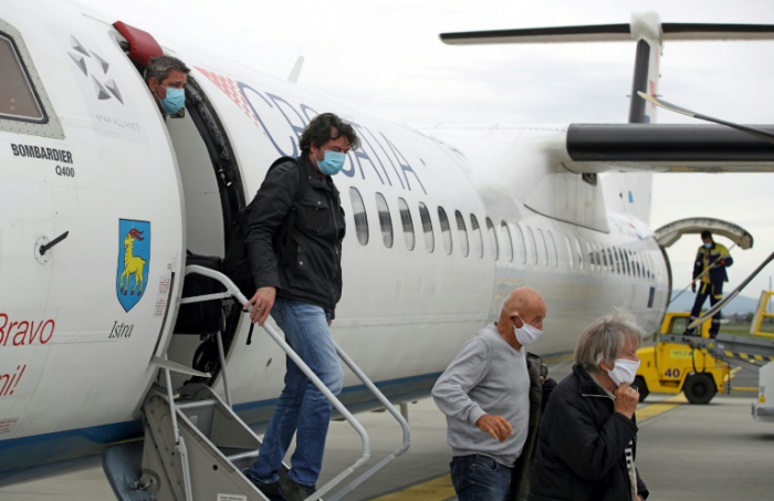 UN-Luftfahrtorganisation empfiehlt ein Meter Abstand zwischen Passagieren