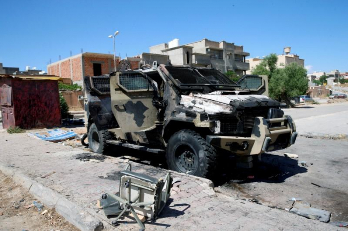 Eastern forces quit Libyan capital after year-long assault
