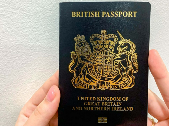 Government mocked over new blue passports being 'black'