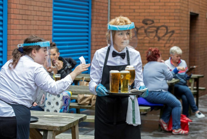 Pubs in England reopen despite lingering coronavirus fears